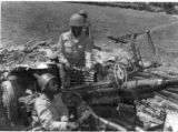 3 soldiers operating a Bofors 40mm gun.