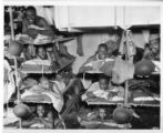 Soldiers in bunk on a ship to Liberia.
