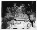 "Soldiers in the Mess Hall eating """"chow""""."